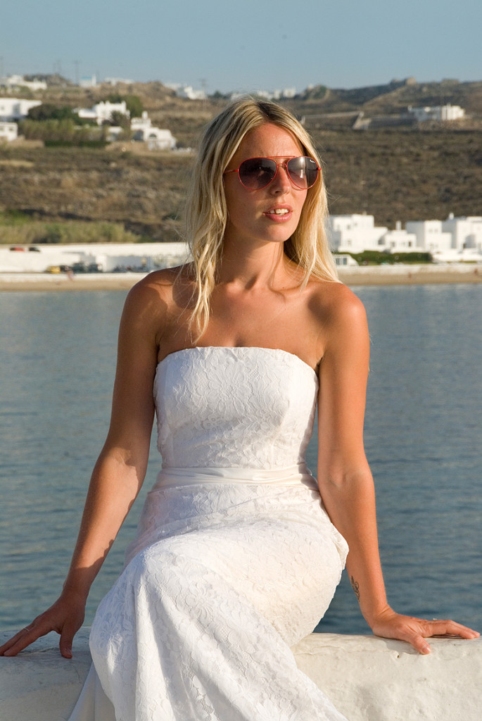 Bride looking over Mykonos bay
