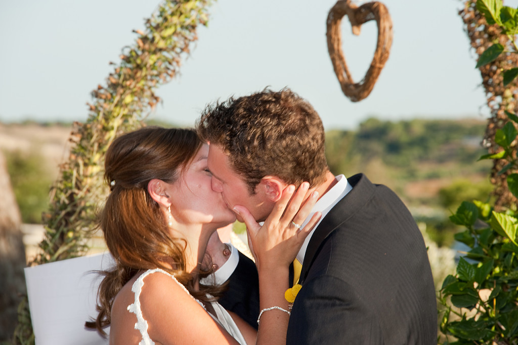 Wedding ceremony kiss